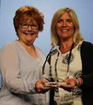 CEO Lydia Dobyns presents Susan Schilling Legacy award to Liz Bryan